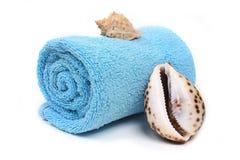 Blue beach towel with seashells Stock Photography