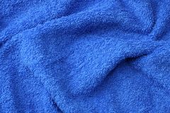 Blue beach towel texture. Blue beach towel background. Top view royalty free stock photo