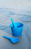 Blue Beach Toys Near the Ocean Royalty Free Stock Photography