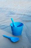 Blue Beach Toys Near the Ocean Royalty Free Stock Photography
