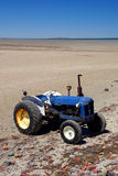 Blue Beach Tractor. An old blue tractor, used for pulling boats up the ramp, on the sandy beach at Port Germein. South Australia Royalty Free Stock Photos