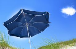 Blue beach umbrella Stock Images