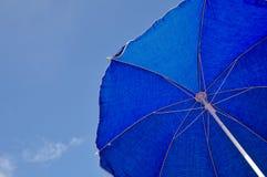 Blue beach umbrella and blue sky Royalty Free Stock Photography