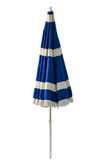 Blue beach umbrella isolated on white Royalty Free Stock Photography