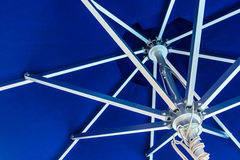 Blue beach umbrella Royalty Free Stock Image