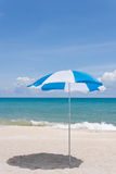 Blue beach umbrella on a sunny day Royalty Free Stock Images