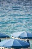 Blue beach umbrellas Royalty Free Stock Photo