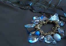Blue bead bracelet on blue Royalty Free Stock Photography