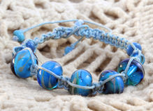Blue beaded bracelet Stock Photos