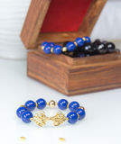 Blue beaded bracelet Stock Images