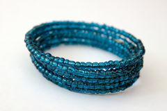 Blue beaded bracelet. On a white background Stock Image