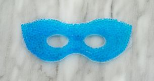Blue beaded gel eye mask on a counter top Stock Photography