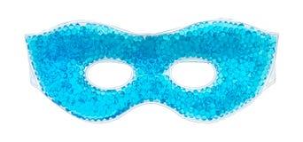 Blue beaded gel eye mask on a white background. A blue beaded gel eye mask isolated on a white background stock image