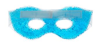 Blue beaded gel eye mask on a white background. A blue beaded gel eye mask upside down showing the strap isolated on a white background Stock Photo
