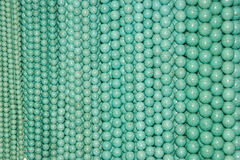 Blue Beads. Hangin blue beads of different sizes Stock Image