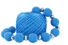 Blue beads. Crochet jewelry - blue round beads stock image
