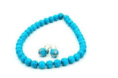 Blue beads and earrings Stock Image