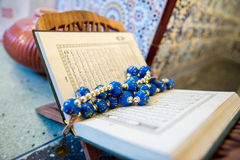 Blue beads. Embedded in the Quran Stock Photo