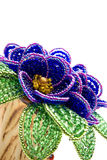 Blue  beads  flower with green leafs Stock Photos