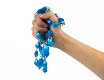 Blue beads in a hand Stock Photography