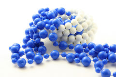 Blue beads isolated. Blue beaded necklace isolated on pure white Stock Image