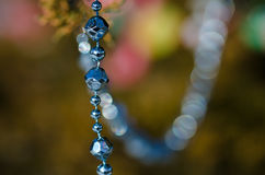 Blue Beads Strung on the Outdoor Christmas Tree Stock Photos