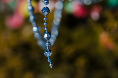 Blue Beads Strung on the Outdoor Christmas Tree Royalty Free Stock Images
