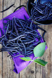 Blue beans on a table Stock Photo