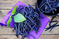 Blue beans on a wooden table Royalty Free Stock Photography