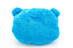 Blue bear pillow. Isolated on white background royalty free stock photo