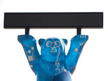 Blue Bear sculpture holds scoreboard Stock Images