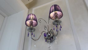 Blue beautiful chandelier on a white wall. stock video footage