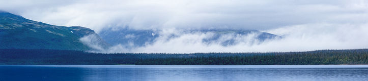 Blue beautiful lake, clouds and mountains Royalty Free Stock Photos