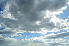 Blue beautiful sky with white clouds  in sunny day Royalty Free Stock Photo