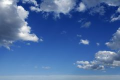 Blue beautiful sky with white clouds in sunny day stock images