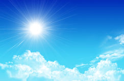 Blue beauty. Sky with clouds and sun background. Royalty Free Stock Photo