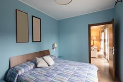 Blue bedroom with frames on the wall Royalty Free Stock Photos