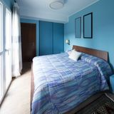 Blue bedroom with frames on the wall Stock Photos