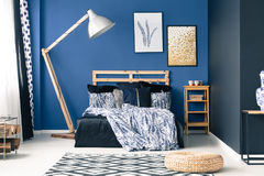 Blue bedroom with gold accents. Modern bedroom in shades of blue with gold accents Royalty Free Stock Photo