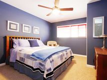 Blue bedroom interioe with navy bedding. Stock Images
