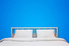 Blue bedroom. Interior of white bedroom with blue cement wall background Stock Photos