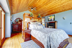 Blue bedroom with wood ceiling Royalty Free Stock Photos