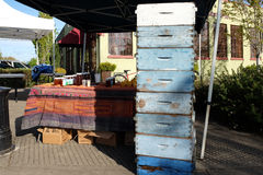 Blue beehive boxes on display at honey booth at farmers market Royalty Free Stock Photos