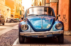 Blue beetle car  in historic center. A blue beetle car in historic center of Bologna - Italy Stock Photo