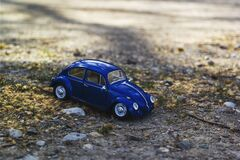 Blue Beetle Car on Yellow and Green Grass Royalty Free Stock Photo