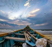 Blue and Beige Boat on Sand Near Ocean royalty free stock images