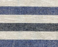 Blue, beige, gray stripe pattern on linen fabric Royalty Free Stock Photography
