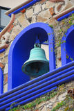 Blue bell. Blue ornamental bell installed on a hacienda style hotel Royalty Free Stock Photo