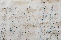 Blue Bells Ropes and Handholds on Climbing Wall Royalty Free Stock Photography