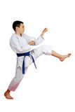 With a blue belt athlete beat a direct kick leg Royalty Free Stock Photography
